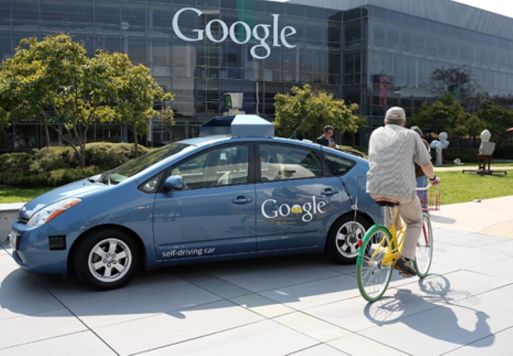 MOUNTAIN VIEW, CA - SEPTEMBER 25:  A bicyclist rides by a Google self-driving car at the Google headquarters on September 25, 2012 in Mountain View, California.  California Gov. Jerry Brown signed State Senate Bill 1298 that allows driverless cars to operate on public roads for testing purposes. The bill also calls for the Department of Motor Vehicles to adopt regulations that govern licensing, bonding, testing and operation of the driverless vehicles before January 2015.  (Photo by Justin Sullivan/Getty Images)